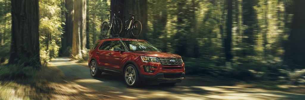 Ford Explorer driving through a forest