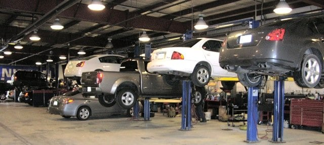 cars being working on at the Balise Nissan of West Springfield service center