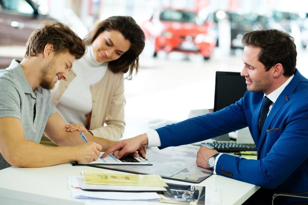 Couple Signing Subaru Lease