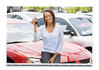 a woman sitting on her red car holding car keys.