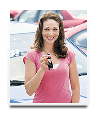 a woman holding her brand new car keys purchased from rizzacars!