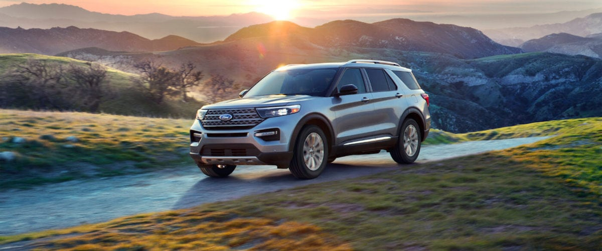 A silver 2020 Ford Explorer driving through the countryside