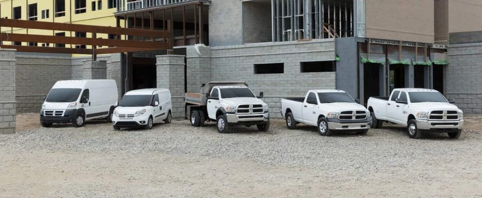 Thee Ram Model Lineup parked at a construction site