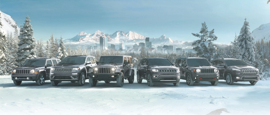 The Jeep model lineup parked in the snow