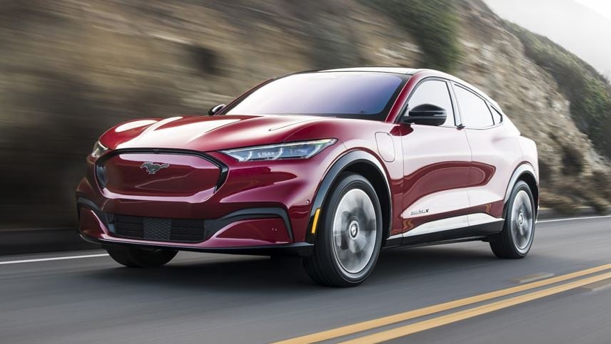 2021 Ford Mustang Mach-E in Red Driving Down Street