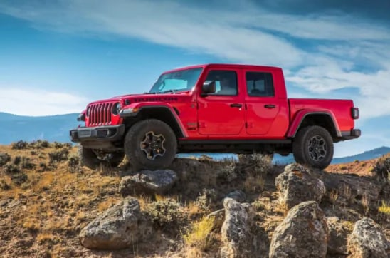 Jeep Gladiator EcoDiesel Truck in Red on Rocks