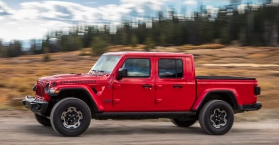 2020 Jeep Gladiator in Red Driving Down Street
