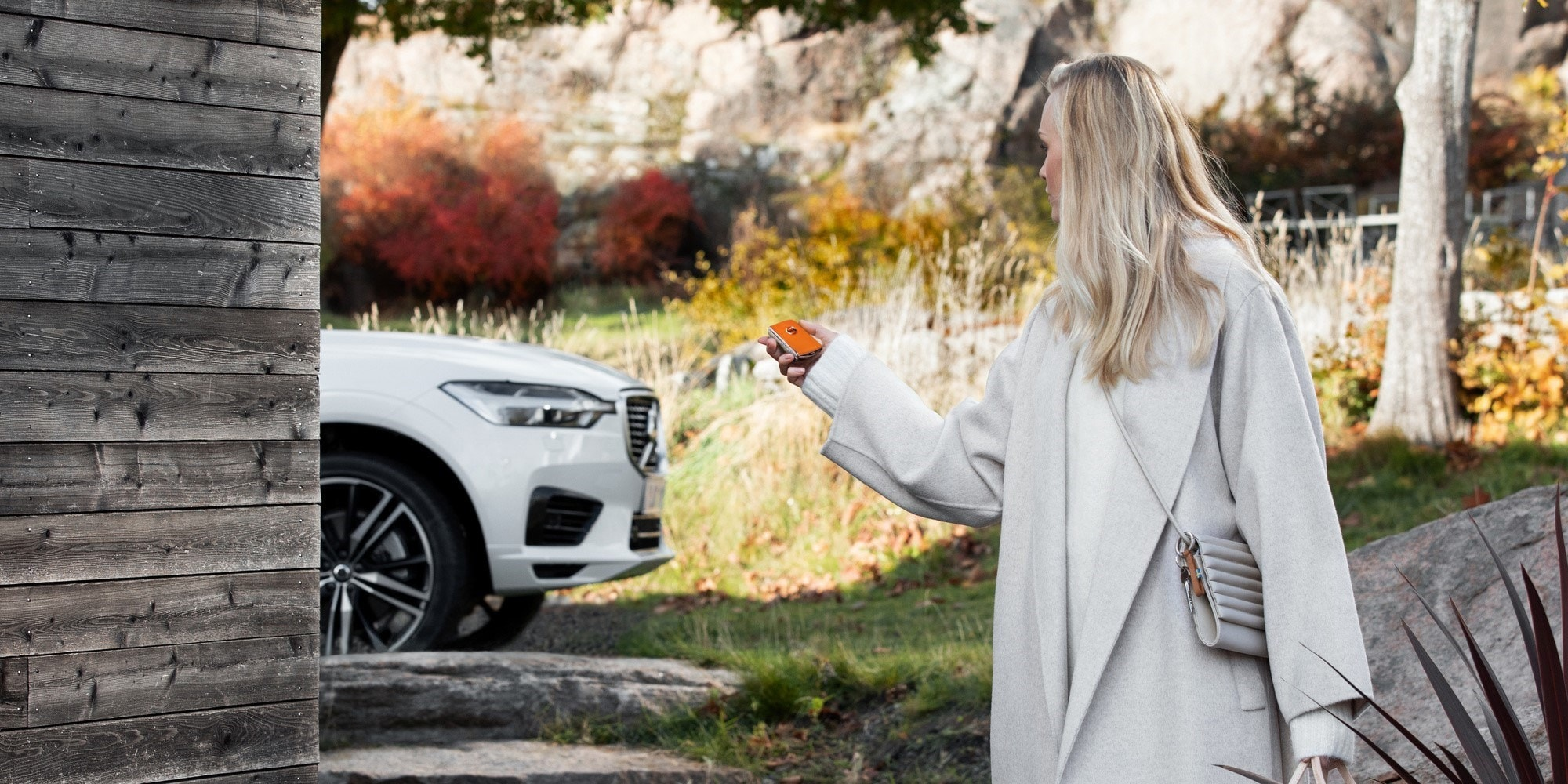 woman in front of volvo