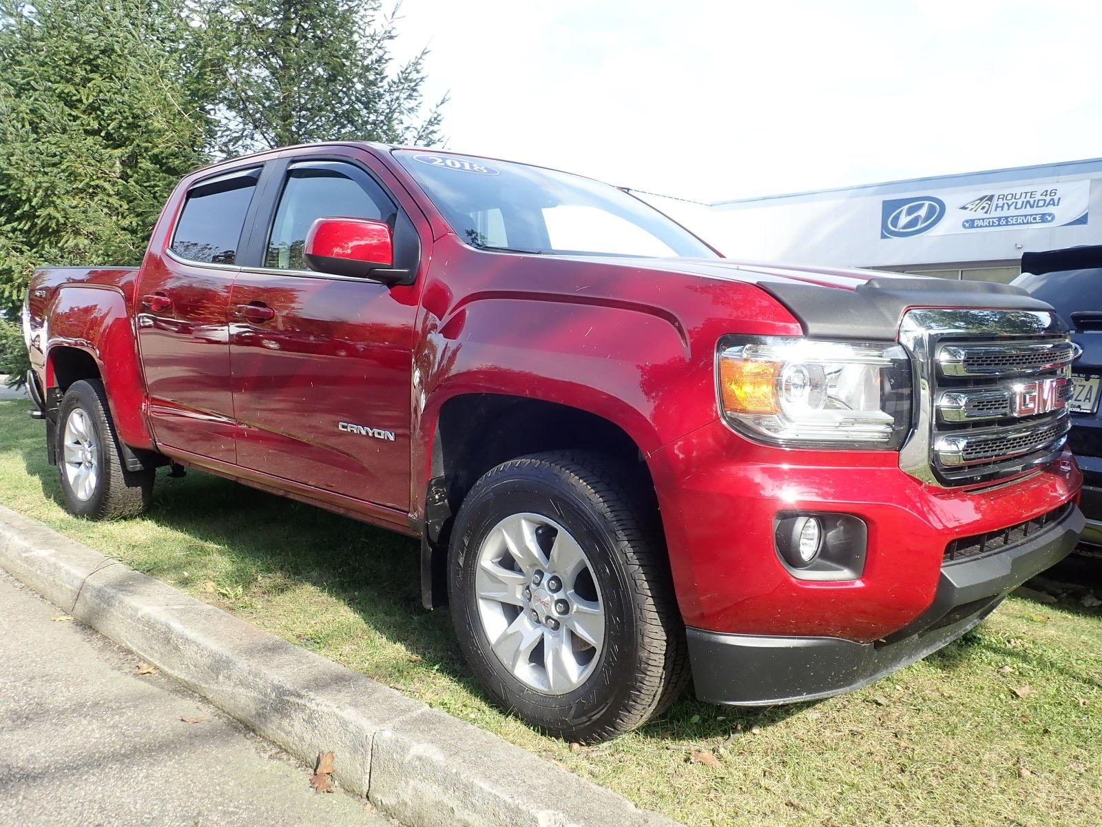 Featured used cars, trucks, and SUVs 2018 GMC Canyon 4WD SLE 4WD Crew Cab 128.3 SLE for sale near you in Newton, NJ