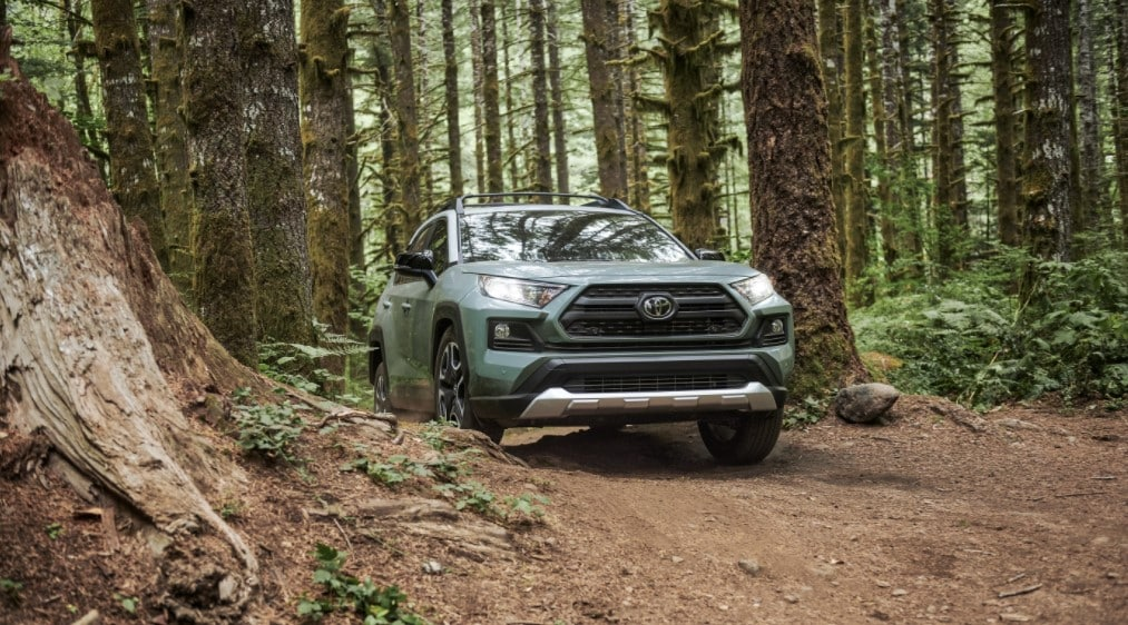 2021 toyota rav4 in adventure grade driving off-road in forest