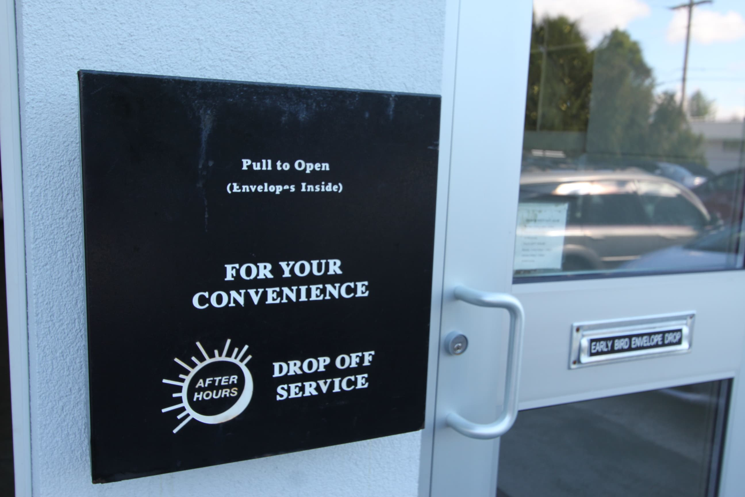24 hour drop-off plaque at our car service center