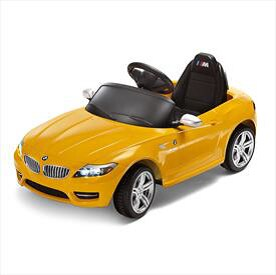 97abee4a1a7 Making acceleration fun with this electronic BMW Z4 ride-on. Features a  horn with indicator and engine sounds. Includes key, MP3 interface and loud  speaker.