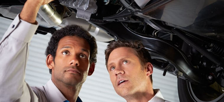 Mazda Technicians Inspecting Certified Pre-Owned Mazda