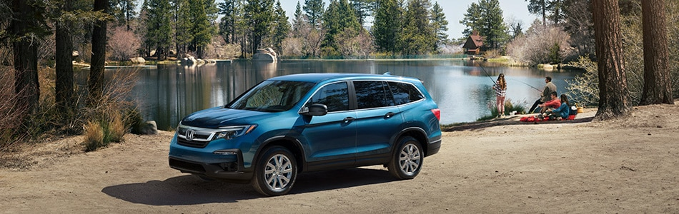 New Honda Pilot near the lake