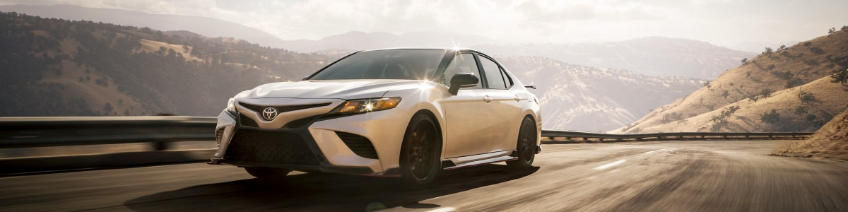 All new Toyota Camry TRD driving through the mountains