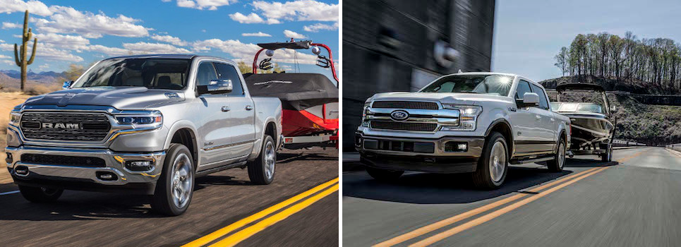 A 2019 Ram 1500 & a 2019 Ford F-150 Towing boats