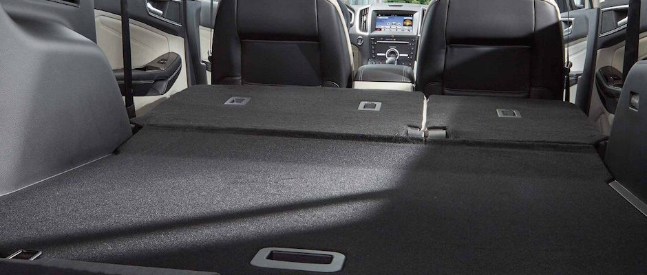 Seats Folded Down In The Back Of A  Ford Suv