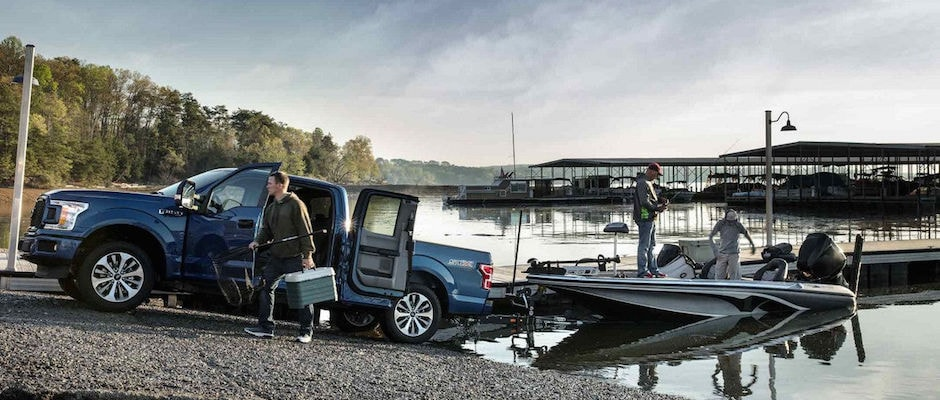 A family taking their Ford on a fishing trip