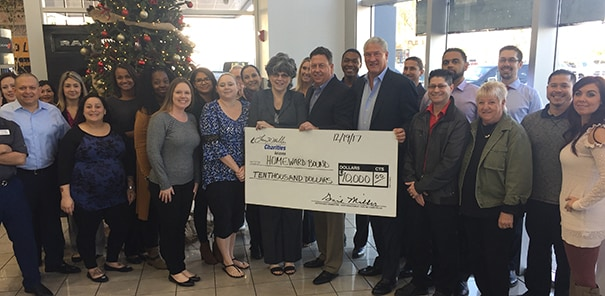 $10,000 donation to Homeward Bound from Larry H. Miller Dealerships, presented by Larry H Miller Dodge Ram Avondale