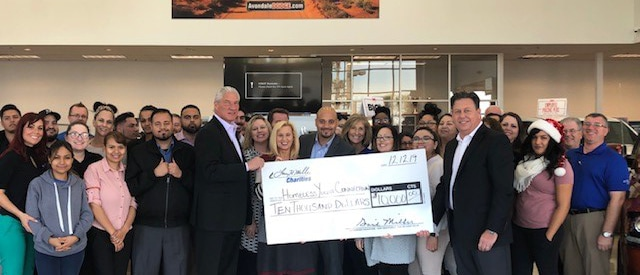$10,000 donation to Homeless Youth Connection from Larry H. Miller Dealerships, presented by Larry H Miller Dodge Ram Avondale