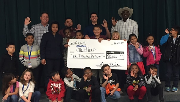 $10,000 donation to ChildHelp from Larry H. Miller Dealerships, presented by Larry H Miller Dodge Ram Avondale