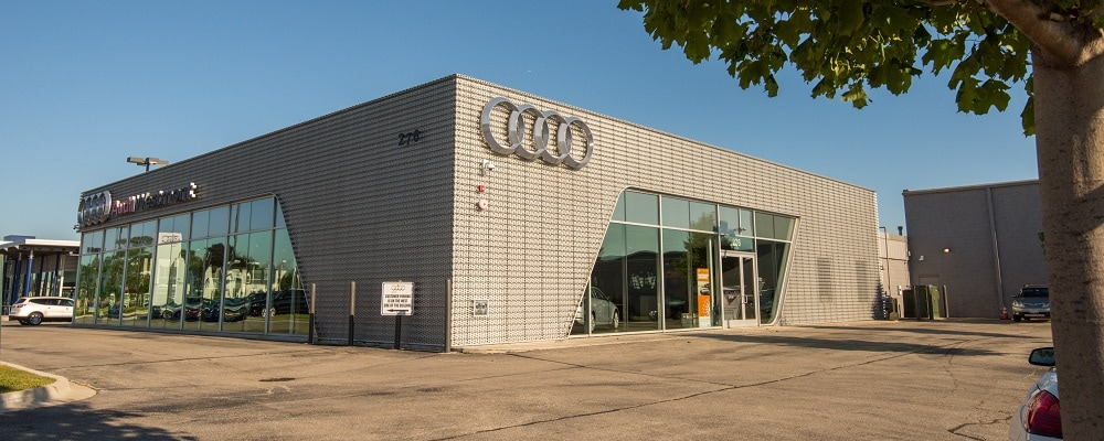 Exterior entrance to Audi Westmont dealer during the day
