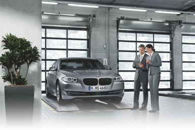 BMW technician performing service