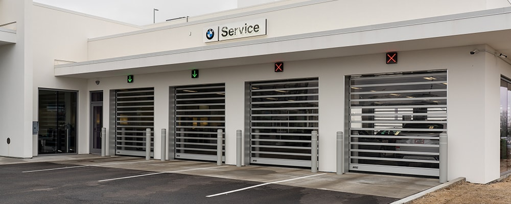View of BMW service bay and service technicians at Lauren BMW of Westmont