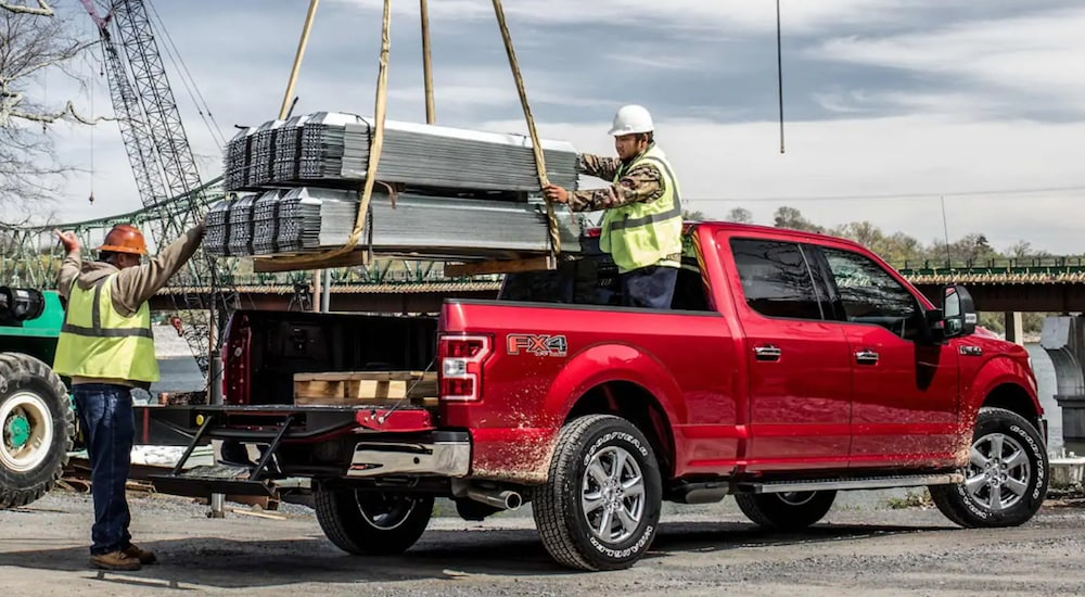 Workers Loading Cargo Into The 2020 Ford F-150 Truck Bed