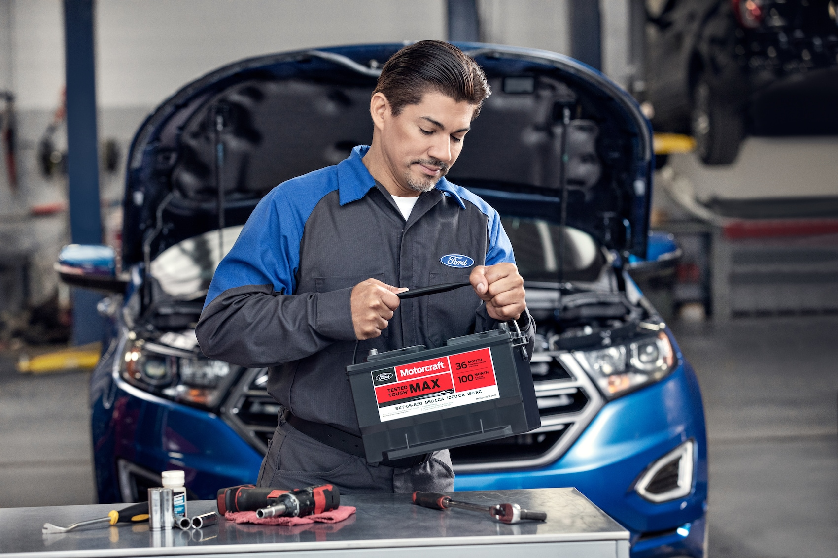 Len Stoler Ford is a Ford Dealership in Owings Mills near Woodlawn MD | technician checking engine