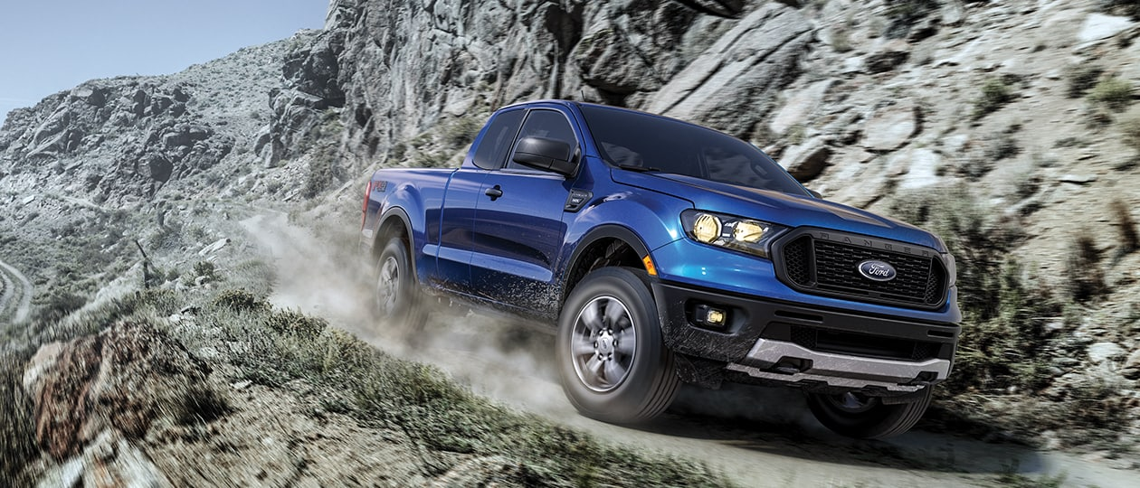 2019 ranger driving fast around a cliff road