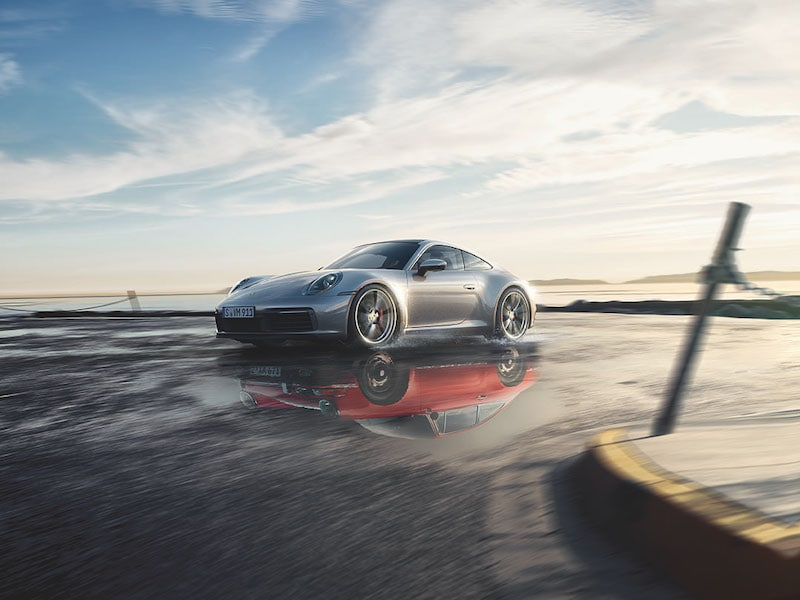 Model features of the 2020 Porsche 911 Carrera Models at Len Stoler Porsche of Owings Mills | 2020 911 Carrera racing