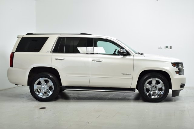 Used 2015 Chevrolet Tahoe LTZ with VIN 1GNSKCKC6FR261138 for sale in Maplewood, Minnesota