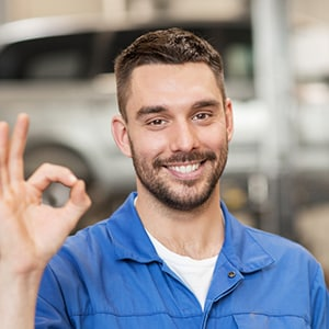 A Good Local Car Mechanic giving OKAY sign