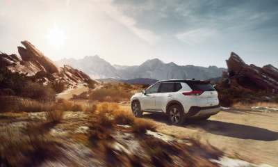 Nissan Rogue driving in sand