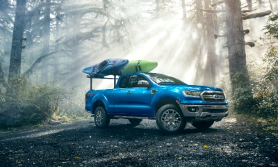 Ford Ranger parked in forest