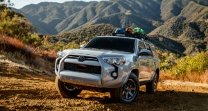 Silver Toyota 4Runner driving off-road