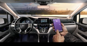Honda Odyssey interior front end including touch screen display with smartphone connectivity