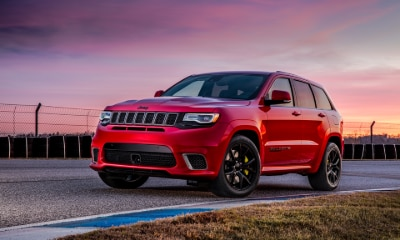 red Jeep Grand Cherokee Trackhawk driving outside