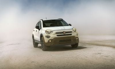White Fiat 500X driving in the desert