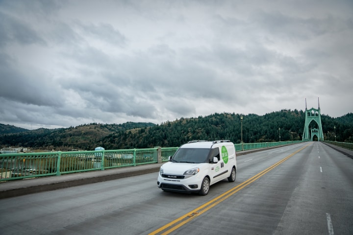 Ram ProMaster driving over a bridge