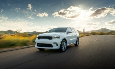 Dodge Durango driving with sunset