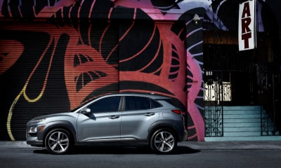 Hyundai Kona parked in front of mural