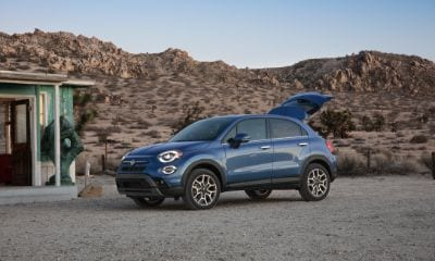 Blue Fiat 500X parked outside with the trunk open