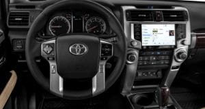 interior of a Toyota 4Runner showing steering wheel and infotainment system