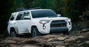 white Toyota 4Runner driving off-road