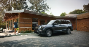 Honda Pilot parked in driveway