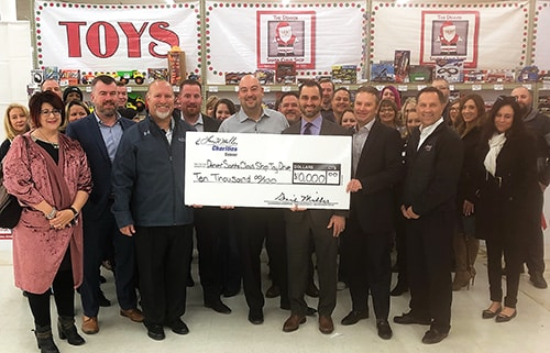 Larry H Miller Jeep Dealership Denver Charity Donation
