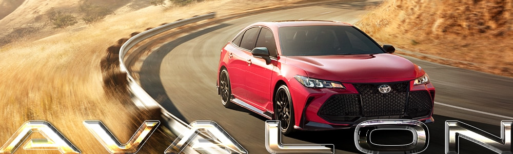 Red 2019 Toyota Avalon driving in the country through wheat fields