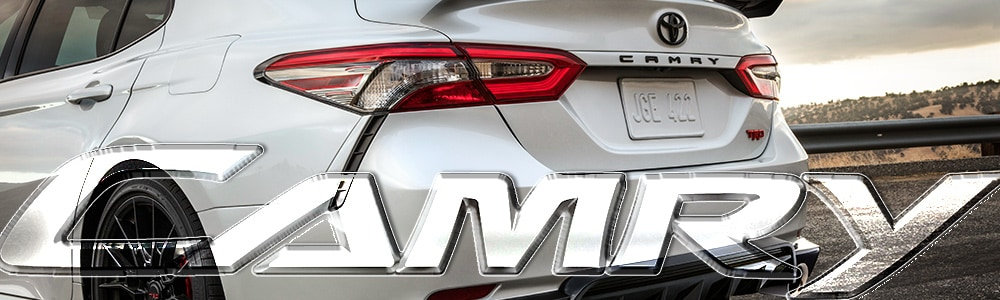 Rear View of a white 2019 Toyota Camry with Black trim